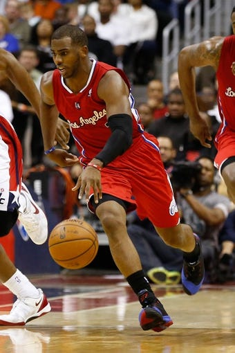 Dec 14, 2013; Washington, DC, USA; Los Angeles Clippers point guard Chris Paul (3) dribbles the ball against the Washington Wizards at Verizon Center. Mandatory Credit: Geoff Burke-USA TODAY Sports