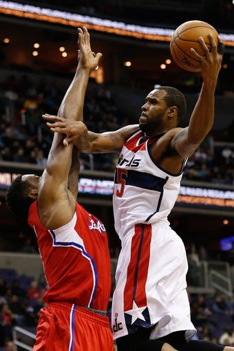 Dec 14, 2013; Washington, DC, USA; Washington Wizards power forward Trevor Booker (35) shoots the ball over Los Angeles Clippers center DeAndre Jordan (6) at Verizon Center. Mandatory Credit: Geoff Burke-USA TODAY Sports