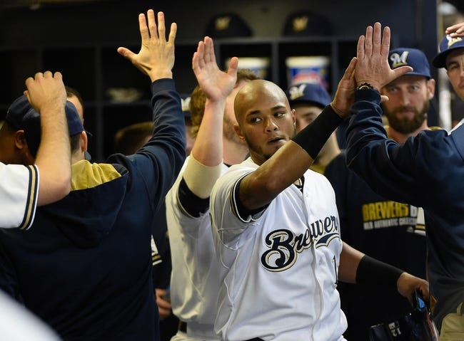 May 5, 2014; Milwaukee, WI, USA;   Milwaukee Brewers catcher Martin Maldonado (12) is greeted in the dugout after hitting a 2-run homer in the second inning against the Arizona Diamondbacks at Miller Park. Mandatory Credit: Benny Sieu-USA TODAY Sports