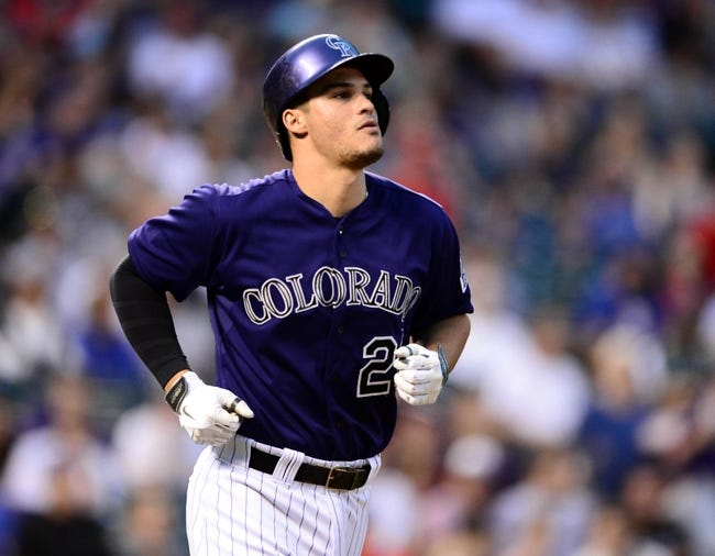 May 5, 2014; Denver, CO, USA; Colorado Rockies third baseman Nolan Arenado (28) is intentionally walked by the Texas Rangers in the fourth inning at Coors Field. Mandatory Credit: Ron Chenoy-USA TODAY Sports