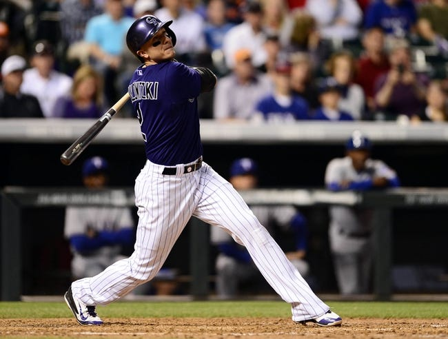 May 5, 2014; Denver, CO, USA; Colorado Rockies shortstop Troy Tulowitzki (2) hits a home run in the fifth inning against the Texas Rangers at Coors Field. Mandatory Credit: Ron Chenoy-USA TODAY Sports