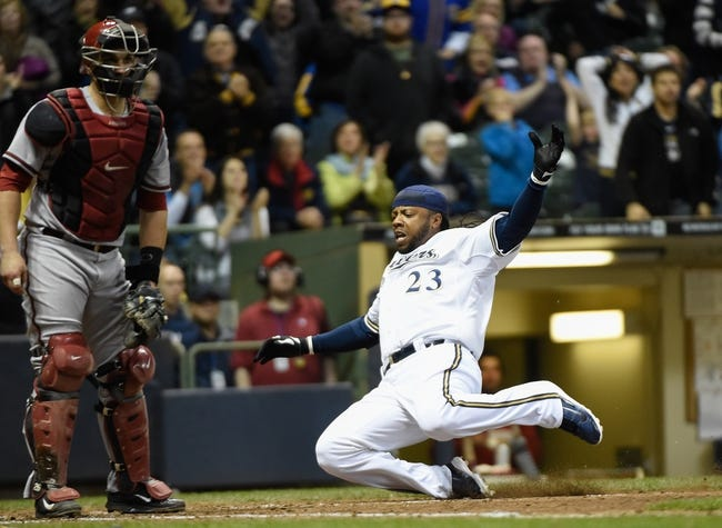 May 5, 2014; Milwaukee, WI, USA;   Milwaukee Brewers second baseman Rickie Weeks (23) scores in front of Arizona Diamondbacks catcher Miguel Montero (26) in the sixth inning at Miller Park. Mandatory Credit: Benny Sieu-USA TODAY Sports