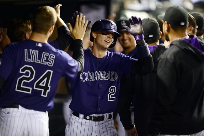 May 5, 2014; Denver, CO, USA; Colorado Rockies shortstop Troy Tulowitzki (2) reacts after hitting his third home run of the game against the Texas Rangers in the seventh inning against the Texas Rangers at Coors Field. Mandatory Credit: Ron Chenoy-USA TODAY Sports
