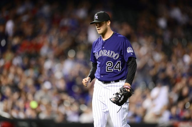 May 5, 2014; Denver, CO, USA; Colorado Rockies starting pitcher Jordan Lyles (24) reacts to closing out the top of the eighth inning against the Texas Rangers at Coors Field. Mandatory Credit: Ron Chenoy-USA TODAY Sports
