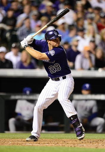 May 5, 2014; Denver, CO, USA; Colorado Rockies third baseman Nolan Arenado (28) at the plate in the fifth inning against the Texas Rangers at Coors Field. Mandatory Credit: Ron Chenoy-USA TODAY Sports