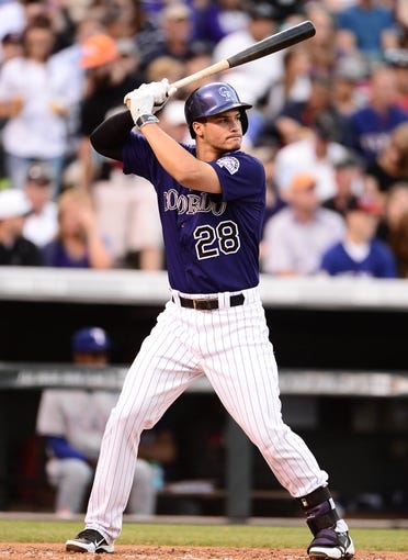 May 5, 2014; Denver, CO, USA; Colorado Rockies third baseman Nolan Arenado (28) at the plate in the second inning against the Texas Rangers at Coors Field. Mandatory Credit: Ron Chenoy-USA TODAY Sports