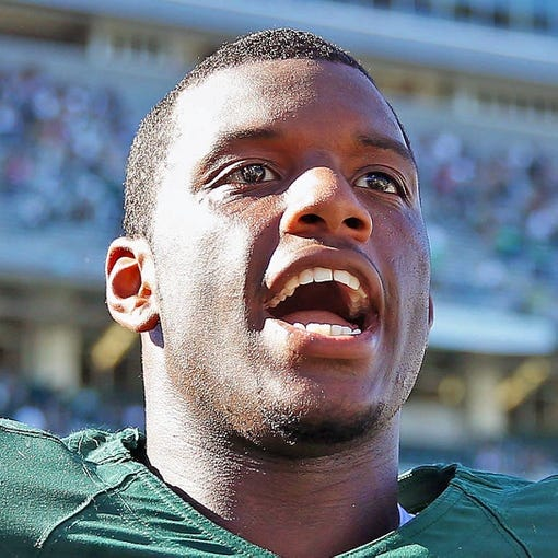 Oct 12, 2013; East Lansing, MI, USA; Michigan State Spartans defensive end Shilique Calhoun (89) celebrates the win against Indiana Hoosiers after a game at Spartan Stadium. Mandatory Credit: Mike Carter-USA TODAY Sports