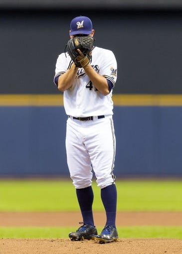 May 6, 2014; Milwaukee, WI, USA; Milwaukee Brewers pitcher Marco Estrada (41) during the first inning against the Arizona Diamondbacks at Miller Park. Mandatory Credit: Jeff Hanisch-USA TODAY Sports