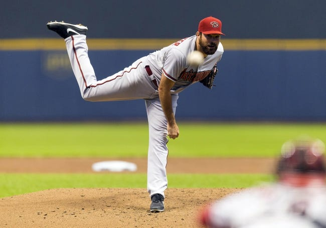 May 6, 2014; Milwaukee, WI, USA; Arizona Diamondbacks pitcher Josh Collmenter (55) throws a pitch during the first inning against the Milwaukee Brewers at Miller Park. Mandatory Credit: Jeff Hanisch-USA TODAY Sports