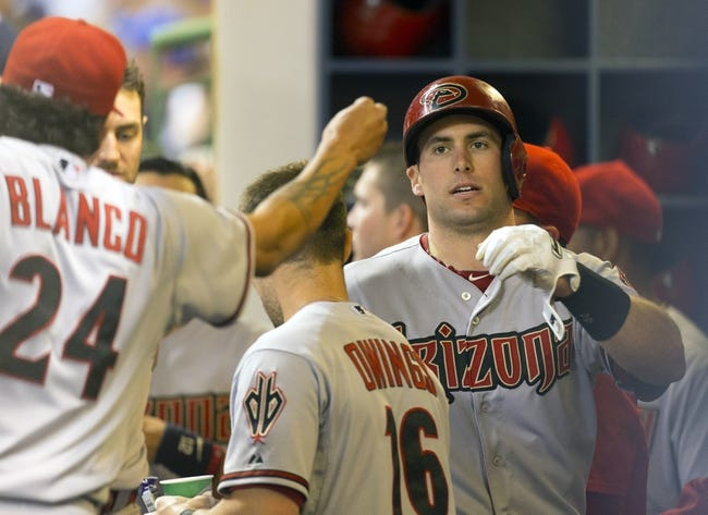 May 6, 2014; Milwaukee, WI, USA; Arizona Diamondbacks first baseman Paul Goldschmidt (44) is greeted by teammates after scoring a run during the eighth inning against the Milwaukee Brewers at Miller Park. Mandatory Credit: Jeff Hanisch-USA TODAY Sports