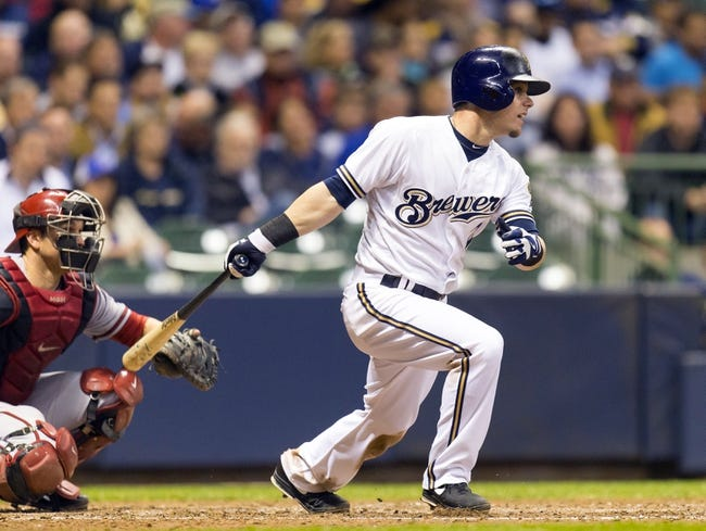 May 6, 2014; Milwaukee, WI, USA; Milwaukee Brewers second baseman Scooter Gennett (2) singles during the sixth inning against the Arizona Diamondbacks at Miller Park. Mandatory Credit: Jeff Hanisch-USA TODAY Sports