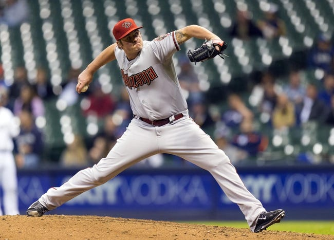 May 6, 2014; Milwaukee, WI, USA; Arizona Diamondbacks pitcher Addison Reed (43) throws a pitch during the ninth inning against the Milwaukee Brewers at Miller Park. Mandatory Credit: Jeff Hanisch-USA TODAY Sports