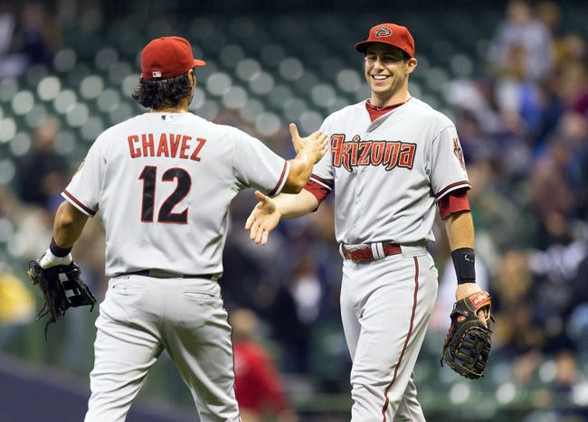 May 6, 2014; Milwaukee, WI, USA; Arizona Diamondbacks third baseman Eric Chavez (12) and first baseman Paul Goldschmidt (44) greet each other following the game against the Milwaukee Brewers at Miller Park.  Arizona won 7-5.  Mandatory Credit: Jeff Hanisch-USA TODAY Sports