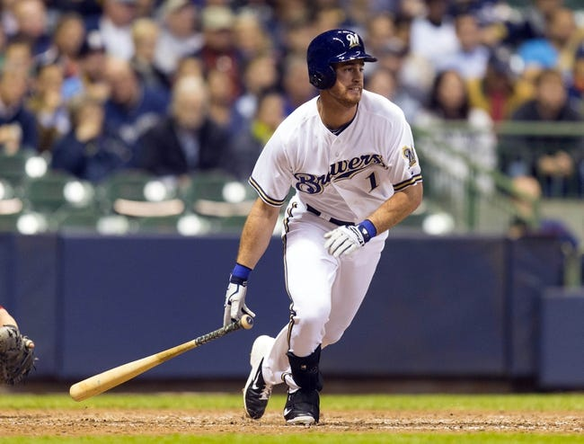 May 6, 2014; Milwaukee, WI, USA; Milwaukee Brewers right fielder Logan Schafer (1) singles during the sixth inning against the Arizona Diamondbacks at Miller Park. Mandatory Credit: Jeff Hanisch-USA TODAY Sports