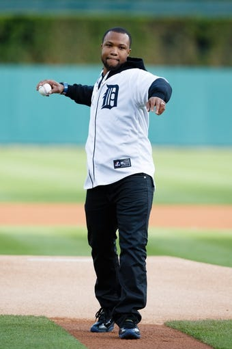 May 5, 2014; Detroit, MI, USA; Detroit Lions safety Glover Quin throws a ceremonial pitch before the game between the Detroit Tigers and the Houston Astros at Comerica Park. Mandatory Credit: Rick Osentoski-USA TODAY Sports