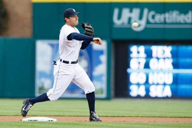 Apr 21, 2014; Detroit, MI, USA; Detroit Tigers second baseman Ian Kinsler (3) makes a throw against the Chicago White Sox at Comerica Park. Mandatory Credit: Rick Osentoski-USA TODAY Sports
