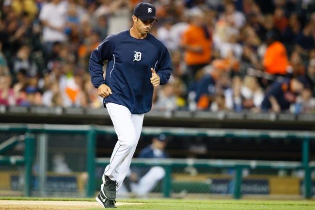Apr 21, 2014; Detroit, MI, USA; Detroit Tigers manager Brad Ausmus (7) runs onto the field against the Chicago White Sox at Comerica Park. Mandatory Credit: Rick Osentoski-USA TODAY Sports