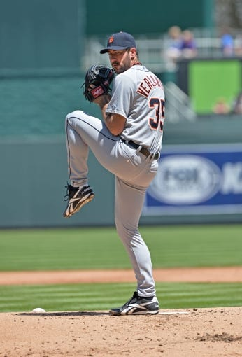 May 4, 2014; Kansas City, MO, USA; Detroit Tigers pitcher Justin Verlander (35) delivers warm up pitch against the Kansas City Royals during the first inning at Kauffman Stadium. Mandatory Credit: Peter G. Aiken-USA TODAY Sports