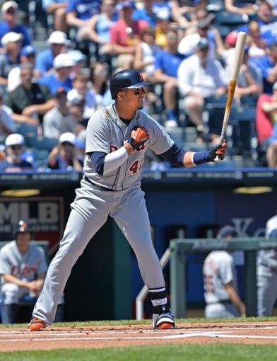 May 4, 2014; Kansas City, MO, USA; Detroit Tigers designated hitter Victor Martinez (41) at bat against the Kansas City Royals during the first inning at Kauffman Stadium. Mandatory Credit: Peter G. Aiken-USA TODAY Sports