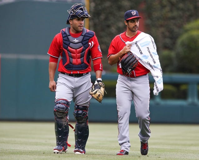 May 4, 2014; Philadelphia, PA, USA; Washington Nationals catcher Sandy Leon (41) and starting pitcher Gio Gonzalez (47) walk to the mound together for the start of a game against the Philadelphia Phillies at Citizens Bank Park. The Phillies defeated the Nationals 1-0. Mandatory Credit: Bill Streicher-USA TODAY Sports