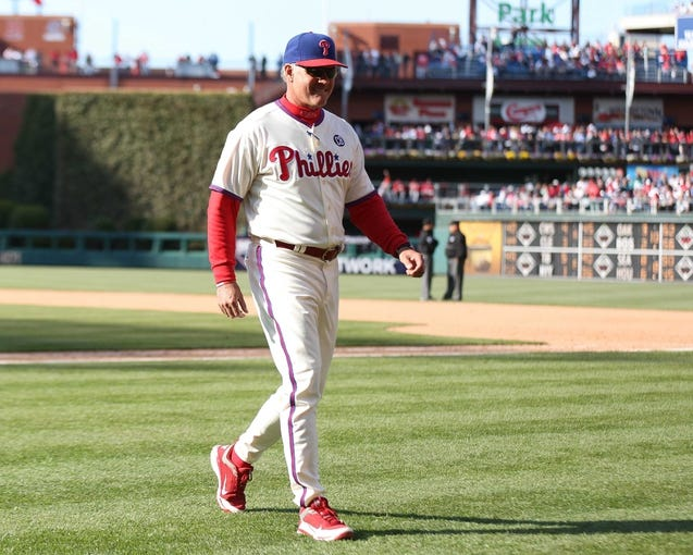 May 4, 2014; Philadelphia, PA, USA; Philadelphia Phillies manager Ryne Sandberg (23) walks back to the dugout in a game against the Washington Nationals at Citizens Bank Park. The Phillies defeated the Nationals 1-0.  Mandatory Credit: Bill Streicher-USA TODAY Sports