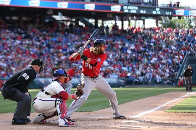 May 4, 2014; Philadelphia, PA, USA; Washington Nationals right fielder Jayson Werth (28) with Philadelphia Phillies catcher Carlos Ruiz (51) and umpire Sean Barber (29) at Citizens Bank Park. The Phillies defeated the Nationals 1-0.  Mandatory Credit: Bill Streicher-USA TODAY Sports