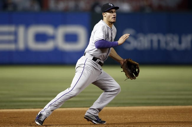 May 7, 2014; Arlington, TX, USA; Colorado Rockies third baseman Nolan Arenado (28) chases the ground-out hit by Texas Rangers right fielder Alex Rios (not pictured) during the fifth inning of a baseball game at Globe Life Park in Arlington. Mandatory Credit: Jim Cowsert-USA TODAY Sports