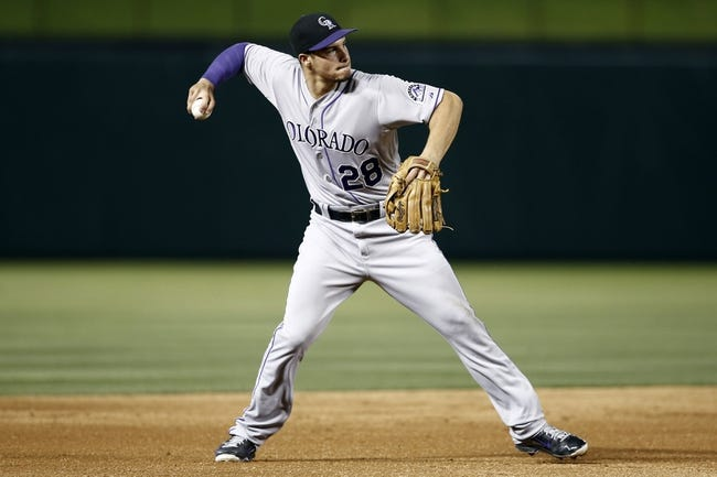 May 7, 2014; Arlington, TX, USA; Colorado Rockies third baseman Nolan Arenado (28) throws to first base on a ground-out hit by Texas Rangers right fielder Alex Rios (not pictured) during the fifth inning of a baseball game at Globe Life Park in Arlington. Mandatory Credit: Jim Cowsert-USA TODAY Sports