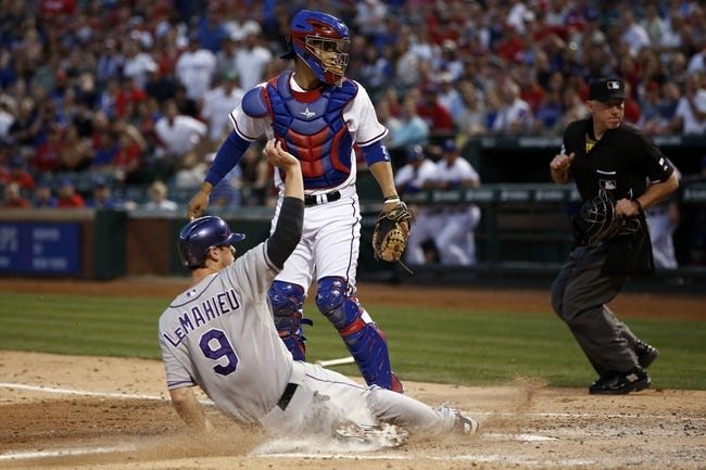 May 7, 2014; Arlington, TX, USA; Colorado Rockies special assistant Vinny Castilla (9) slides home in front of Texas Rangers catcher Robinson Chirinos (61) during the fourth inning of a baseball game at Globe Life Park in Arlington. Mandatory Credit: Jim Cowsert-USA TODAY Sports