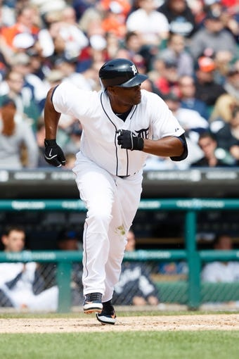 Apr 24, 2014; Detroit, MI, USA; Detroit Tigers right fielder Torii Hunter (48) runs to first against the Chicago White Sox at Comerica Park. Mandatory Credit: Rick Osentoski-USA TODAY Sports