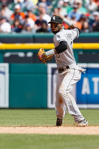 Apr 24, 2014; Detroit, MI, USA; Chicago White Sox shortstop Alexei Ramirez (10) makes a throw against the Detroit Tigers at Comerica Park. Mandatory Credit: Rick Osentoski-USA TODAY Sports