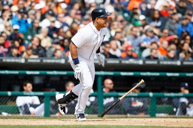 Apr 24, 2014; Detroit, MI, USA; Detroit Tigers first baseman Miguel Cabrera (24) hits a two RBI single in the seventh inning against the Chicago White Sox at Comerica Park. Mandatory Credit: Rick Osentoski-USA TODAY Sports
