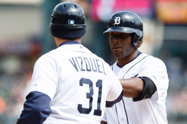 Apr 24, 2014; Detroit, MI, USA; Detroit Tigers right fielder Torii Hunter (48) receives congratulations from first base coach Omar Vizquel (31) after he hits a single against the Chicago White Sox at Comerica Park. Mandatory Credit: Rick Osentoski-USA TODAY Sports