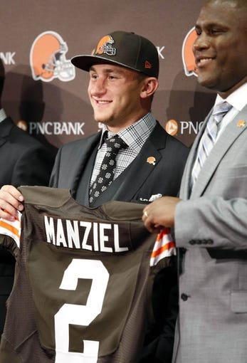 May 9, 2014; Berea, OH, USA; Cleveland Browns general manager Ray Farmer (right) introduces Cleveland Browns first round draft pick Johnny Manziel (Texas A&M) to the media at the Cleveland Browns Headquarters.  Browns general manager Ray Farmer is right of Manziel. Mandatory Credit: Joe Maiorana-USA TODAY Sports