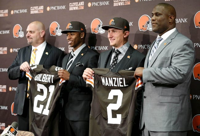 May 9, 2014; Berea, OH, USA; Cleveland Browns first round draft picks Justin Gilbert (Oklahoma State) and Johnny Manziel (Texas A&M) are introduced to the media with head coach Mike Pettine (left) and general Manager Ray Farmer (left) at the Cleveland Browns Headquarters. Mandatory Credit: Joe Maiorana-USA TODAY Sports