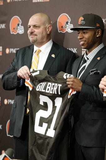 May 9, 2014; Berea, OH, USA; Cleveland Browns first round draft pick Justin Gilbert (Oklahoma State) is introduced at press conference with Browns coach Mike Pettine at the Cleveland Browns Headquarters. Mandatory Credit: Joe Maiorana-USA TODAY Sports
