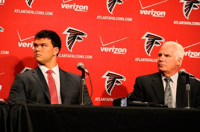 May 9, 2014; Atlanta, GA, USA; Atlanta Falcons first round draft pick tackle Jake Matthews (Texas A&M) listens with Falcons head coach Mike Smith during a press conference at Falcons Training Facility. Mandatory Credit: Dale Zanine-USA TODAY Sports