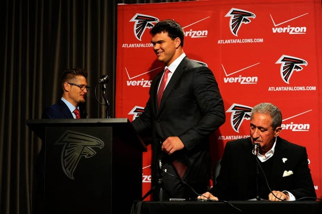 May 9, 2014; Atlanta, GA, USA; Atlanta Falcons general manager Thomas Dimitroff introduces first round draft pick tackle Jake Matthews (center) next to team owner Arthur Blank during a press conference at Falcons Training Facility. Mandatory Credit: Dale Zanine-USA TODAY Sports