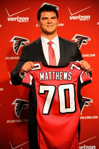 May 9, 2014; Atlanta, GA, USA; Atlanta Falcons first round draft pick tackle Jake Matthews holds a jersey during a press conference at Falcons Training Facility. Mandatory Credit: Dale Zanine-USA TODAY Sports