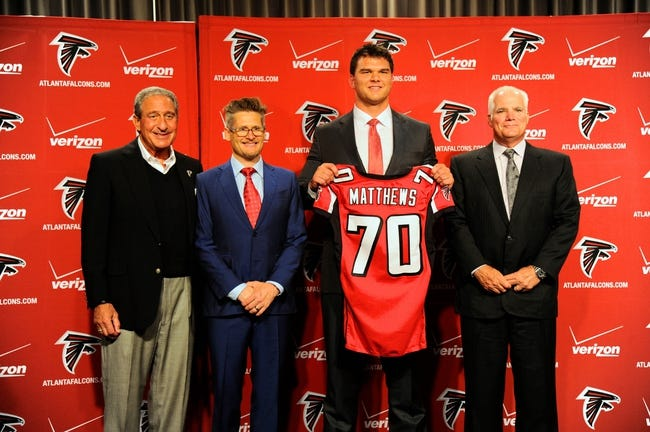 May 9, 2014; Atlanta, GA, USA; Atlanta Falcons team owner Arthur Blank, general manger Thomas Dimitroff first round draft pick tackle Jake Matthews (with jersey) and head coach Mike Smith shown during a press conference at Falcons Training Facility. Mandatory Credit: Dale Zanine-USA TODAY Sports