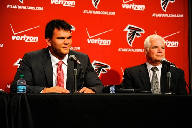 May 9, 2014; Atlanta, GA, USA; Atlanta Falcons first round draft pick tackle Jake Matthews (Texas A&M) speaks next to head coach Mike Smith during a press conference at Falcons Training Facility. Mandatory Credit: Dale Zanine-USA TODAY Sports