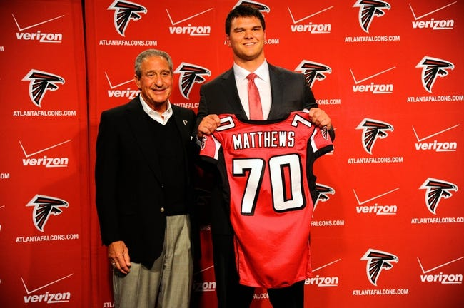 May 9, 2014; Atlanta, GA, USA; Atlanta Falcons team owner Arthur Blank and first round draft pick tackle Jake Matthews (with jersey) shown during a press conference at Falcons Training Facility. Mandatory Credit: Dale Zanine-USA TODAY Sports