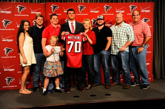 May 9, 2014; Atlanta, GA, USA; Atlanta Falcons first round draft pick tackle Jake Matthews (with jersey) shown with his family during a press conference at Falcons Training Facility. Mandatory Credit: Dale Zanine-USA TODAY Sports