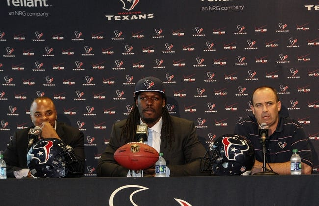 May 9, 2014; Houston, TX, USA; Houston Texans general manager Rick Smith (left) and head coach Bill O'Brien (right) talk to the media during a press conference to introduce first-round draft pick Jadeveon Clowney (middle) at Reliant Stadium. Mandatory Credit: Troy Taormina-USA TODAY Sports