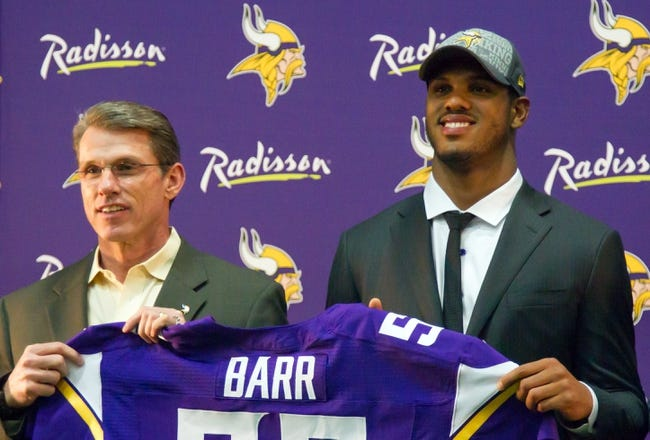 May 9, 2014; Eden Prairie, MN, USA; Minnesota Vikings general manager Rick Spielman (left) poses with linebacker Anthony Barr at Winter Park Fieldhouse. Mandatory Credit: Brad Rempel-USA TODAY Sports