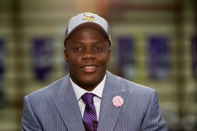 May 9, 2014; Eden Prairie, MN, USA; Minnesota Vikings quarterback Teddy Bridgewater is interviewed by the media  at Winter Park Fieldhouse. Mandatory Credit: Brad Rempel-USA TODAY Sports