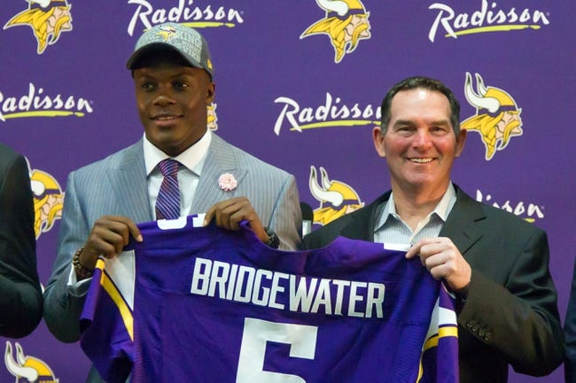 May 9, 2014; Eden Prairie, MN, USA; Minnesota Vikings quarterback Teddy Bridgewater (left) and head coach Mike Zimmer pose for pictures at Winter Park Fieldhouse. Mandatory Credit: Brad Rempel-USA TODAY Sports