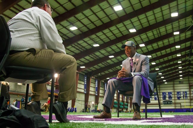May 9, 2014; Eden Prairie, MN, USA; Minnesota Vikings quarterback Teddy Bridgewater gets interviewed by local media Darren Wolfson at Winter Park Fieldhouse. Mandatory Credit: Brad Rempel-USA TODAY Sports