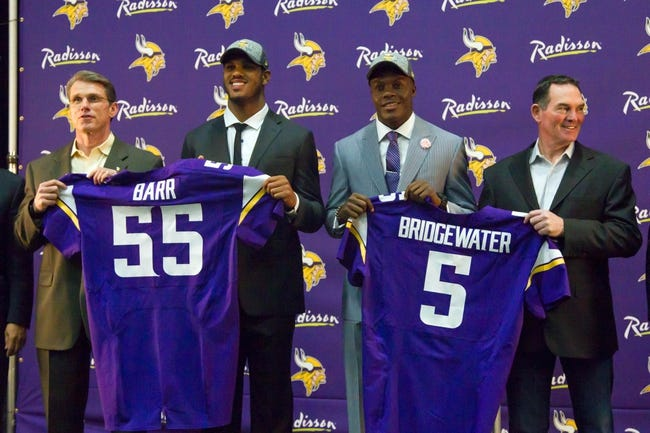 May 9, 2014; Eden Prairie, MN, USA; Minnesota Vikings general manager Rick Spielman (left), linebacker Anthony Barr, quarterback Teddy Bridgewater, and head coach Mike Zimmer (right) pose for pictures at Winter Park Fieldhouse. Mandatory Credit: Brad Rempel-USA TODAY Sports