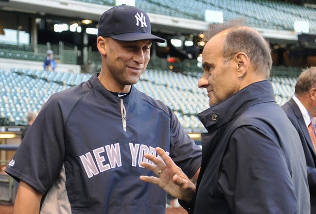 May 9, 2014; Milwaukee, WI, USA;  New York Yankees shortstop Derek Jeter (left) greets former Yankees manager Joe Torre before game against the Milwaukee Brewers at Miller Park. Mandatory Credit: Benny Sieu-USA TODAY Sports